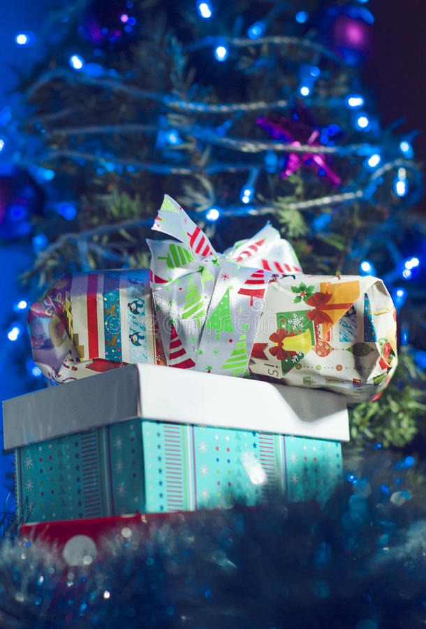 Christmas gifts and the words Merry Christmas. On the background of the Christmas tree and lights royalty free stock photo