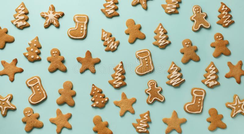 Christmas gingerbread cookies on blue background. Banner. Top view, copy space. New year concept stock photo