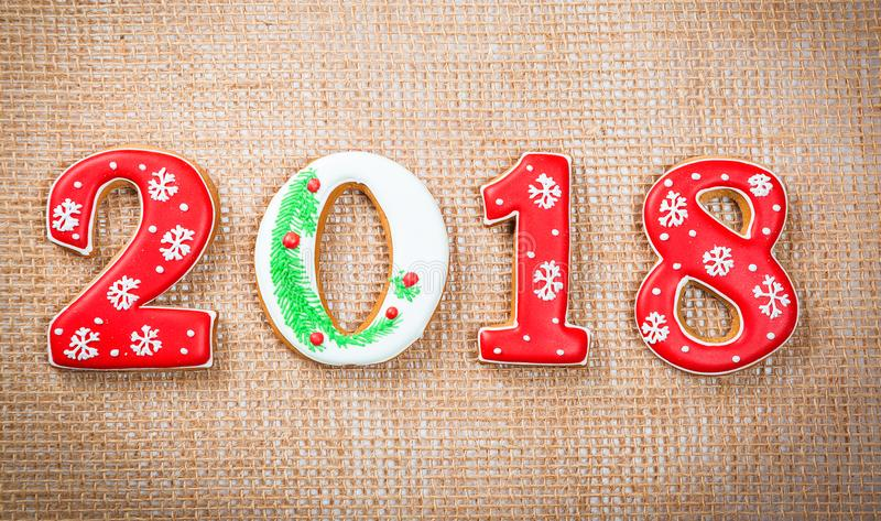 Christmas gingerbread cookies 2018 on burlap background. copy space. Holiday, celebration and cooking concept. Merry Christmas pos stock images