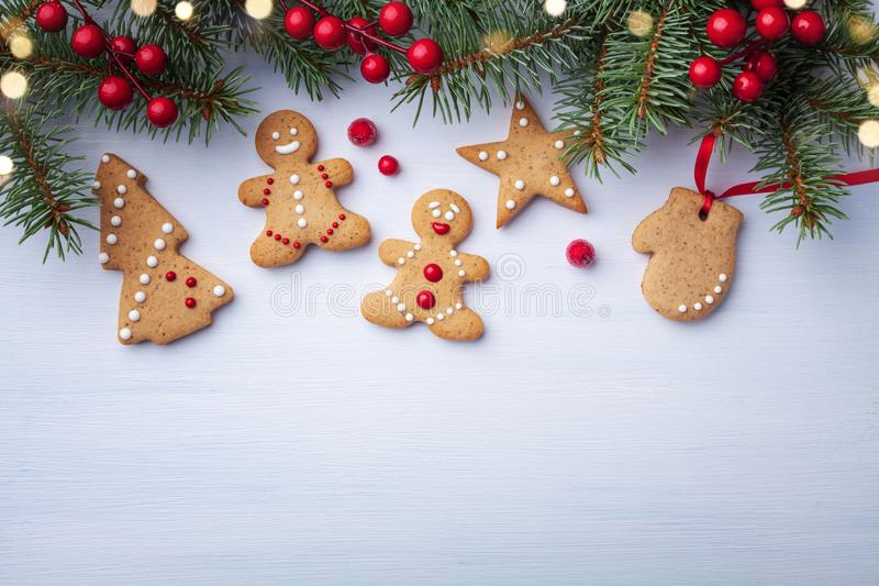 Christmas gingerbread cookies and fir tree on white background top view. Homemade sweet pastries for winter holidays royalty free stock photos