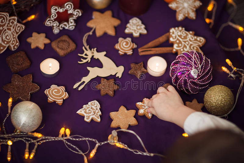 Christmas gingerbread cookies with on purple background. Small B royalty free stock photos