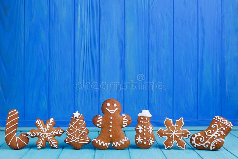 Christmas gingerbread cookies set on bright blue background with royalty free stock images