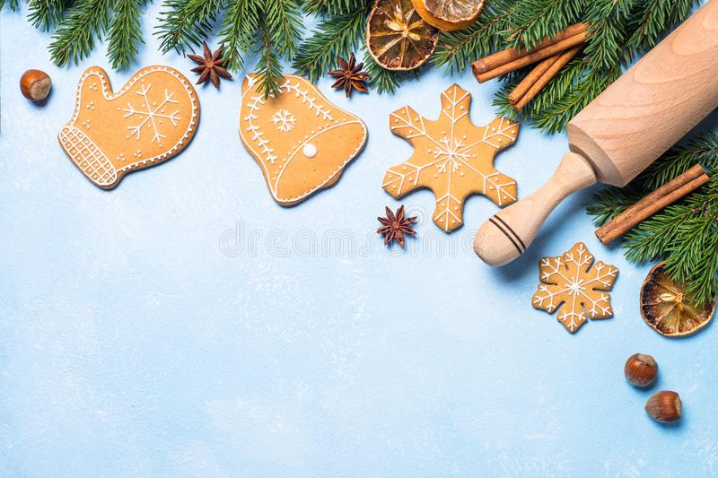 Christmas gingerbread cookies and spices on blue. stock photo