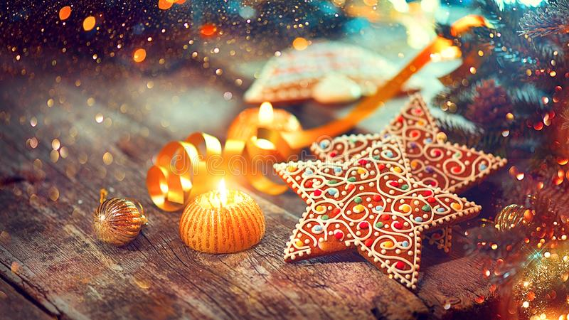 Christmas gingerbread cookies on decorated wooden table royalty free stock images