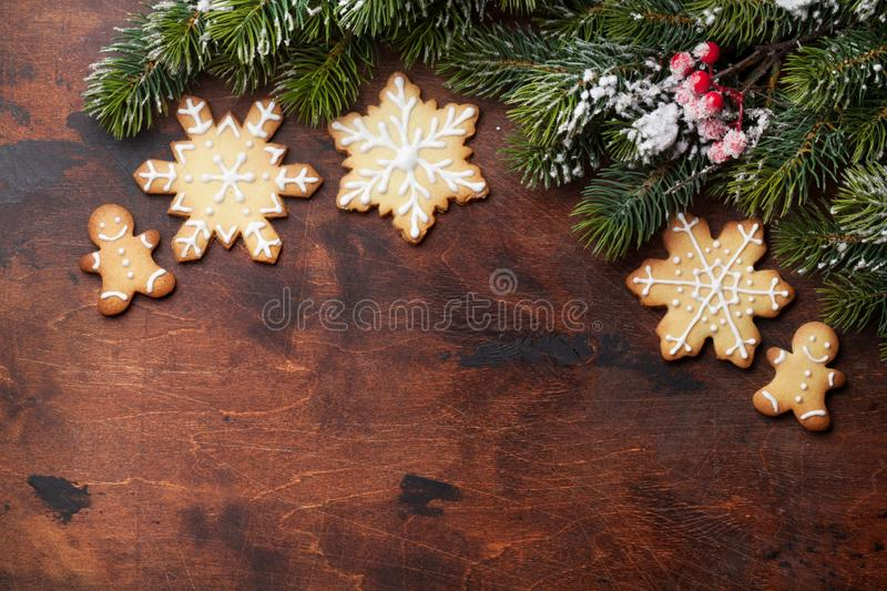 Christmas gingerbread cookies and xmas fir tree royalty free stock photography