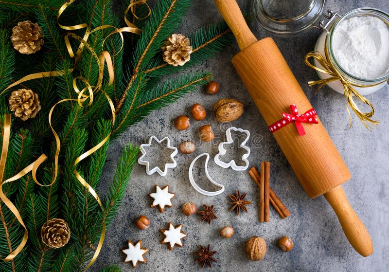 Christmas gingerbread with decoration on a wooden board. royalty free stock image