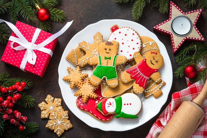 Christmas gingerbread in white plate top view. royalty free stock photos