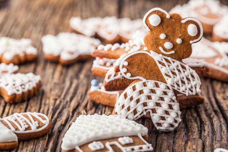 Christmas. Gingerbread family with christmas tree and christmas pastry.  royalty free stock photos