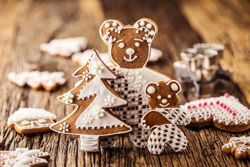 Christmas. Gingerbread family with christmas tree and christmas pastry.  royalty free stock photography