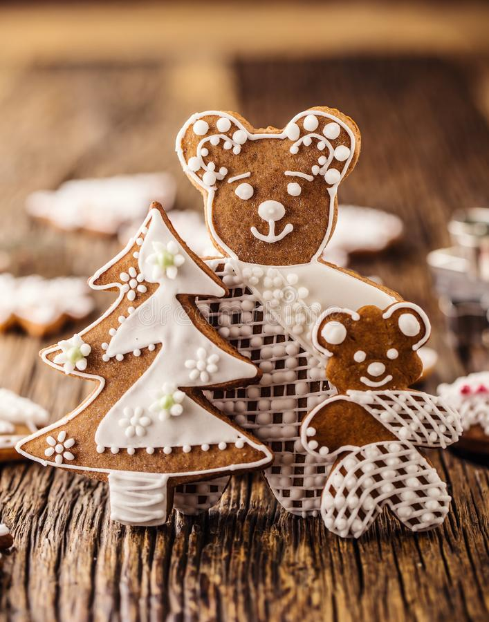 Christmas. Gingerbread family with christmas tree and christmas pastry.  stock photography
