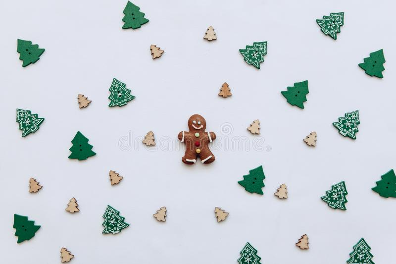 Christmas gingerbread in the form of a small ginger man on a decorated festive background. Christmas or New Year`s concept in a minimal style royalty free stock images