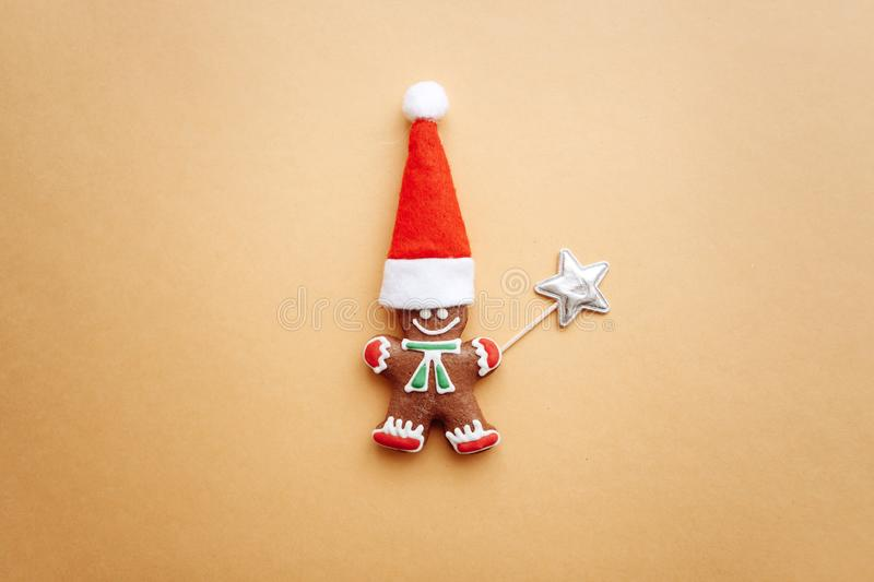 Christmas gingerbread in the form of a small ginger man in a red hat. Wizard. Christmas or New Year`s concept in a minimal style royalty free stock photos