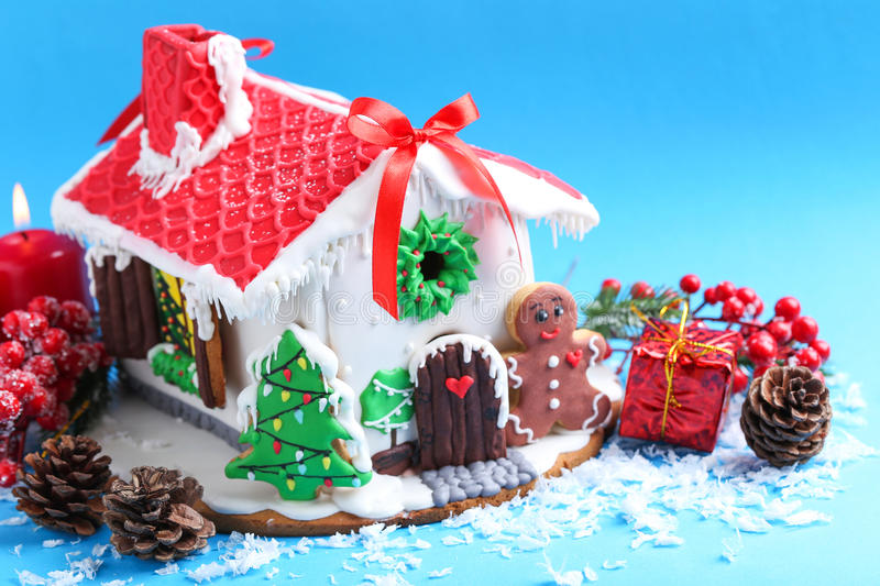 Gingerbread house. Christmas gingerbread house on blue background royalty free stock photography