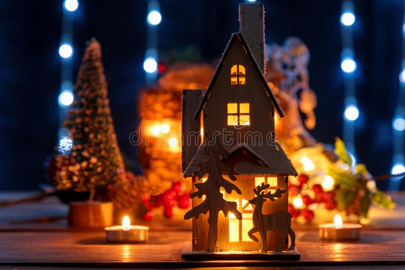 Christmas gingerbread house decoration. Christmas gingerbread house decoration on defocused lights background stock image