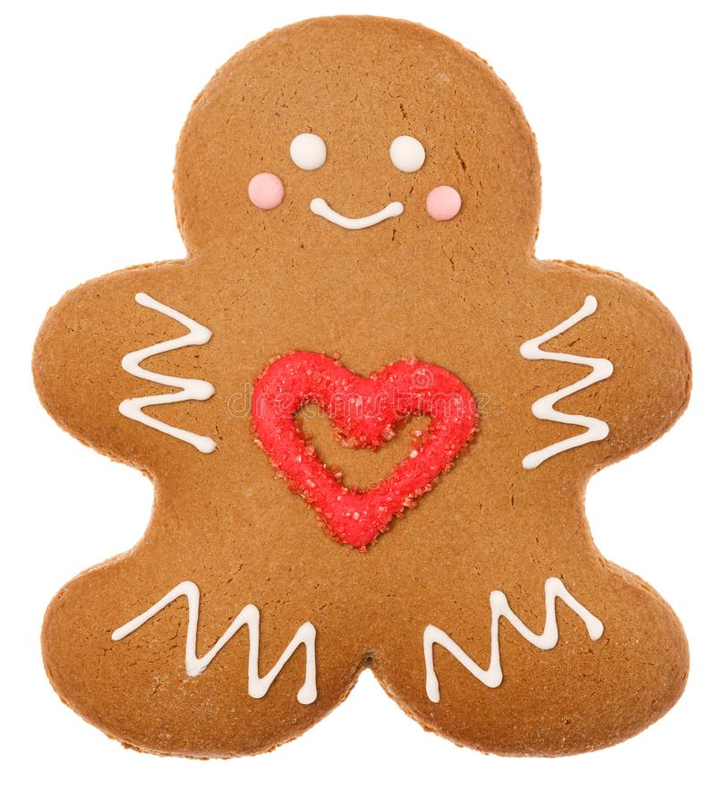 Christmas Gingerbread man biscuit with red heart icing isolated on white background stock photo