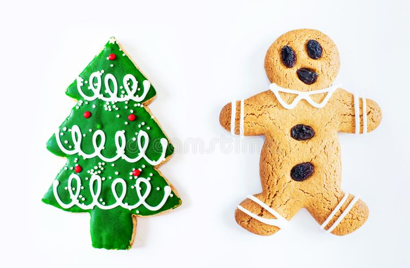 Christmas gingerbread man cookie and Christmas tree cookie isolated on white background. royalty free stock images