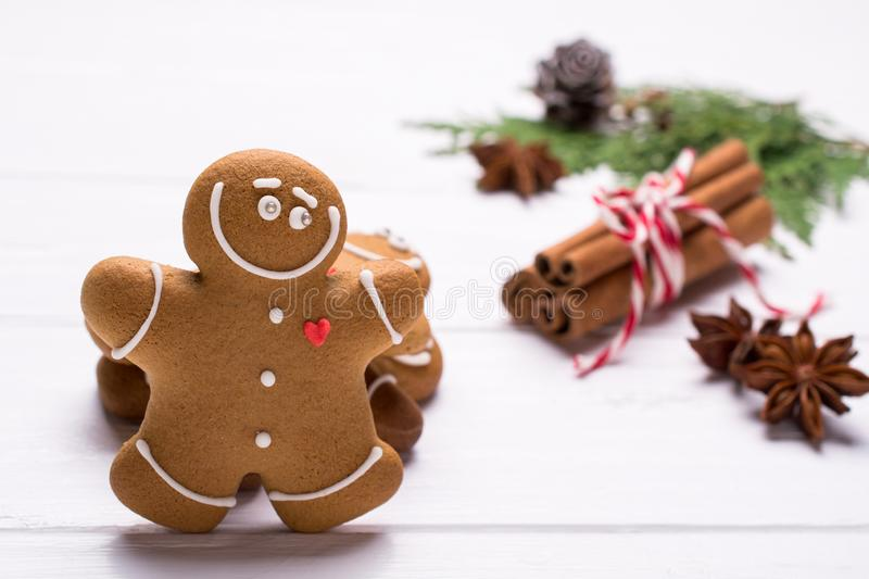 Christmas gingerbread man cookies - Christmas and New Year holiday background. On white with copy-space. Preparation for the holidays. Greeting card stock photography
