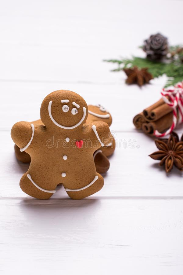 Christmas gingerbread man cookies - Christmas and New Year holiday background. On white with copy-space. Preparation for the holidays. Greeting card royalty free stock photos