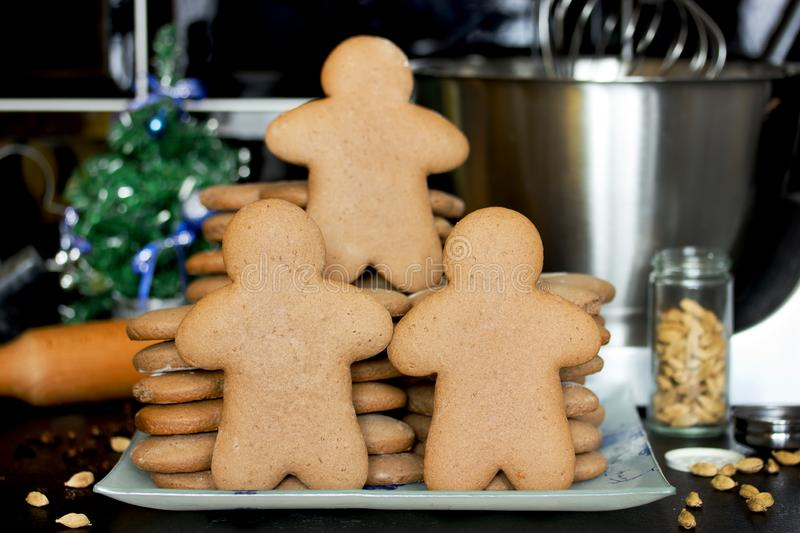 Christmas gingerbread man cookies cooking. Traditional sweet treats for kids on winter holidays stock image