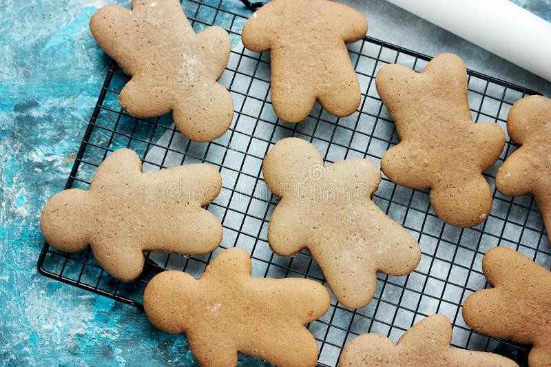 Christmas gingerbread man cookies cooking. Traditional sweet treats for kids on winter holidays royalty free stock photos