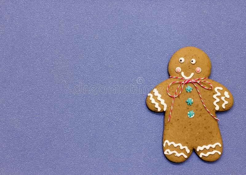 Christmas gingerbread man cookies. Decorated with icing on blue background with copy space royalty free stock photo