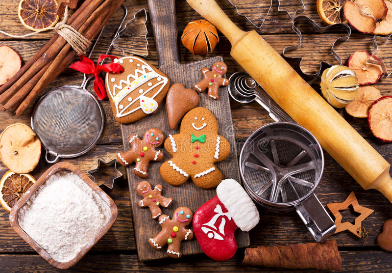 Christmas gingerbread man cookies with ingredients for cooking stock images