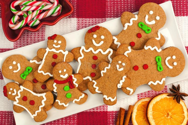 Christmas gingerbread man cookies on plate with checkered background. Christmas gingerbread man cookies on plate with red and white checkered background stock photo