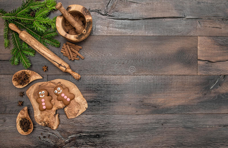 Christmas gingerbread man cookies, spices and baking tools. Holidays food background stock image
