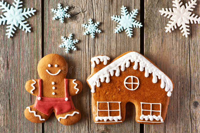Christmas gingerbread man and house cookies. Christmas homemade gingerbread man and house on wooden table stock photo