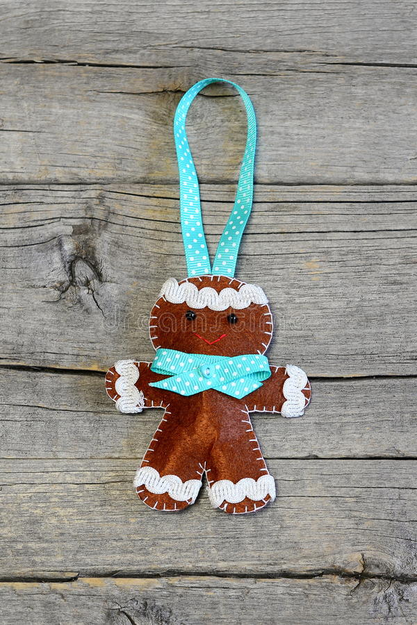 Christmas gingerbread man on old wooden background. Funny felt gingerbread man ornament. Christmas symbol. Top view. Christmas gingerbread man crafts. Christmas stock image