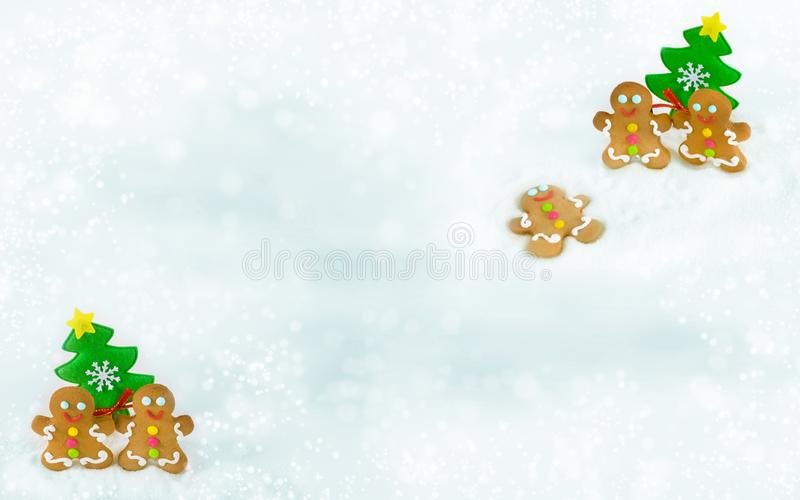 Christmas gingerbread men on the background of snow royalty free stock photos