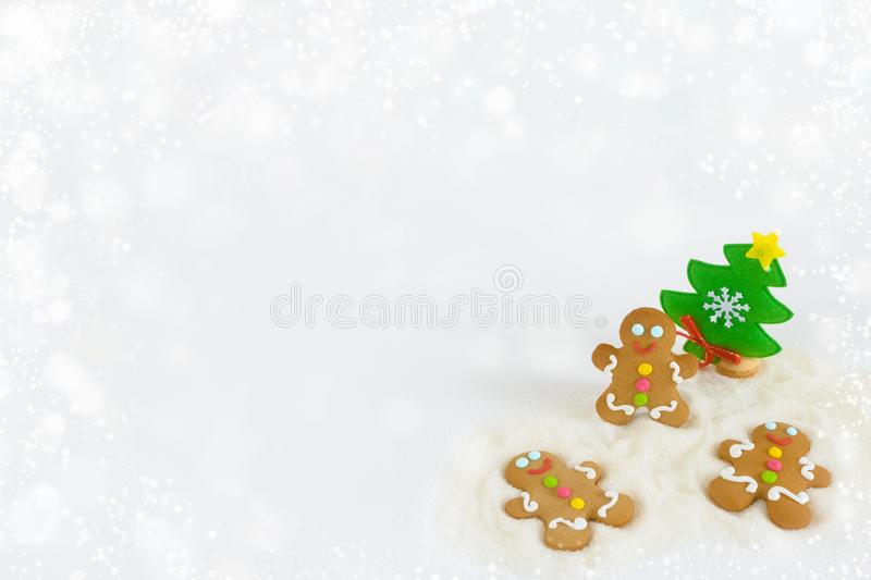 Christmas gingerbread men on the background of snow stock photography