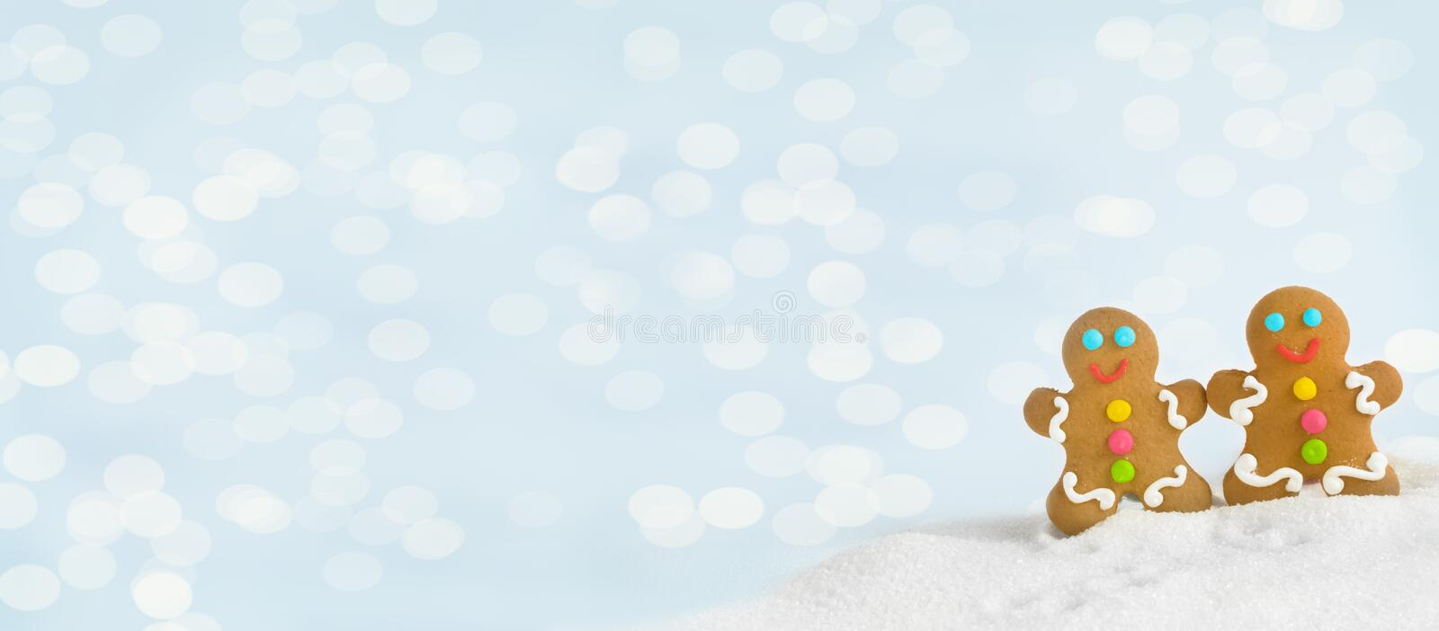 Christmas gingerbread men on the background lights stock photos