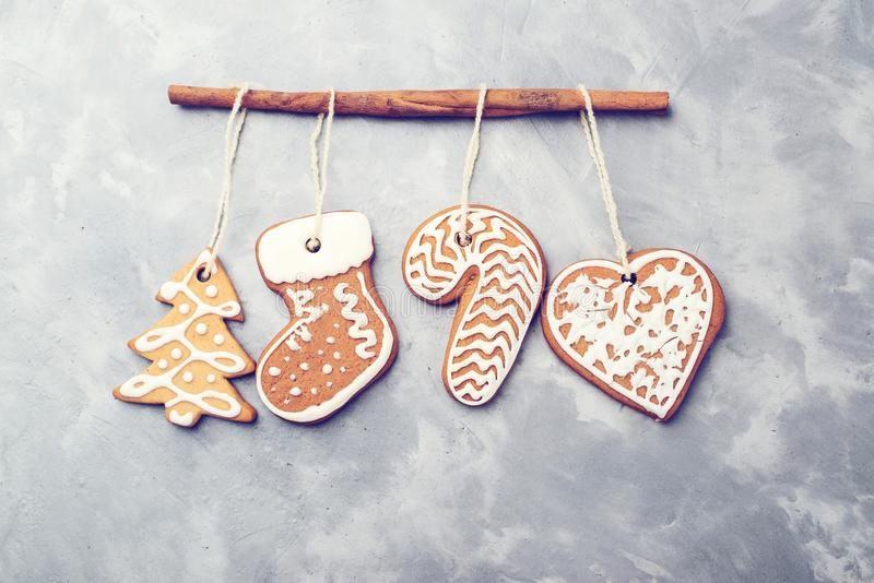 Christmas gingerbreads on concrete background. Copy space. Holiday, celebration and cooking concept. New year and Christmas card. royalty free stock photography