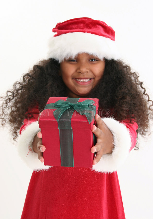 Christmas Girl. Beautiful five year old African American girl in Christmas dress and hat royalty free stock image