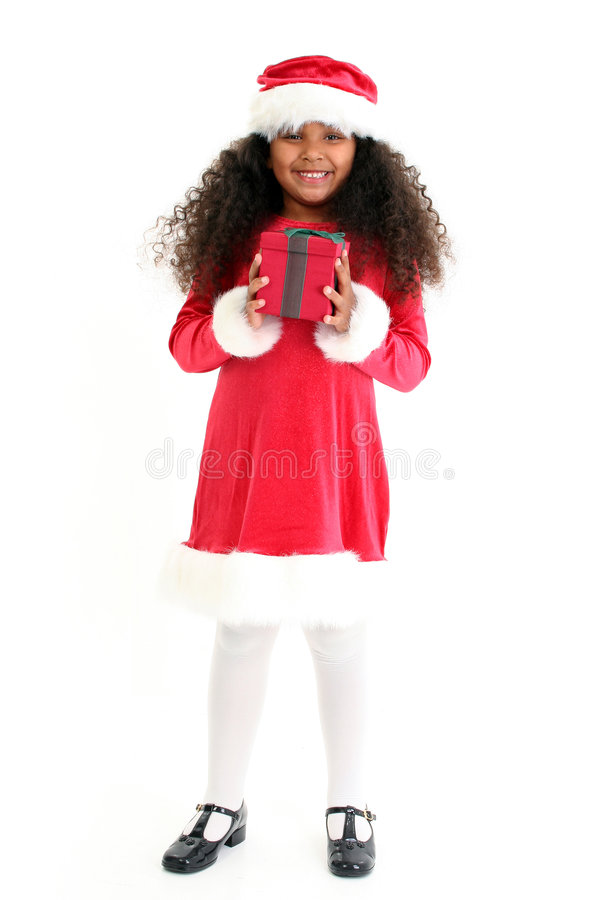Christmas Girl. Beautiful five year old African American girl in Christmas dress and hat royalty free stock photography