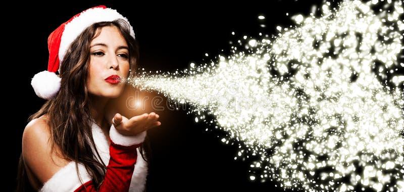 Christmas girl blowing shining snow flakes stock photos