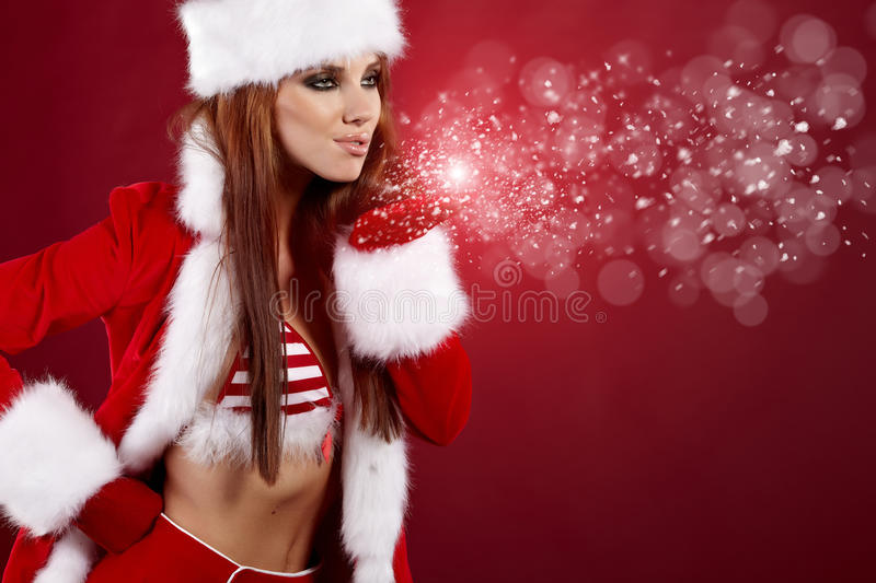 Download Christmas Girl Blowing Snow. Stock Photo - Image: 16939072