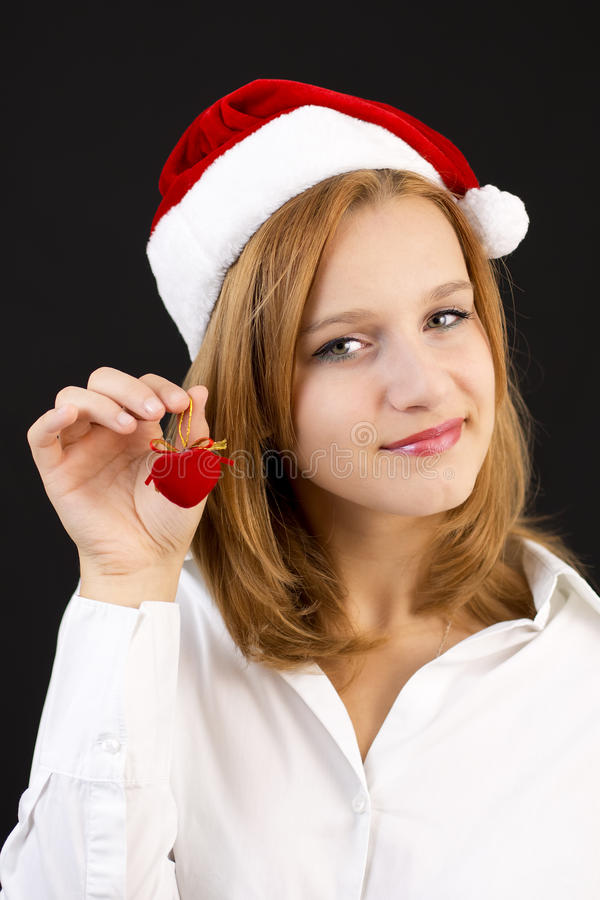 Download Christmas Girl With Christmas Decoration (red Heart) Stock Photo - Image: 35752760