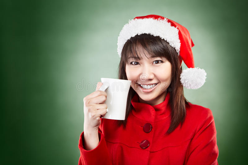Christmas girl with cup of drink