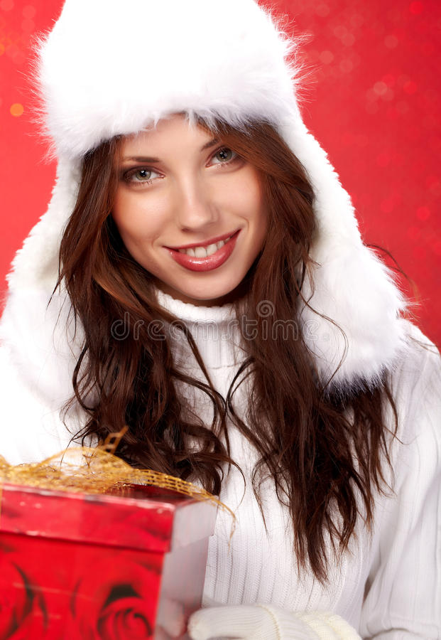 Christmas girl holding a gift in packing royalty free stock images