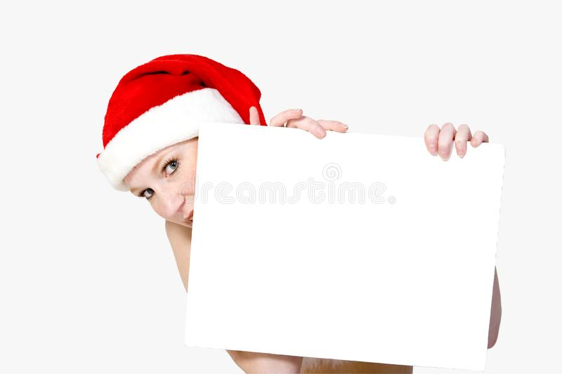 Christmas girl holding up a wh stock image