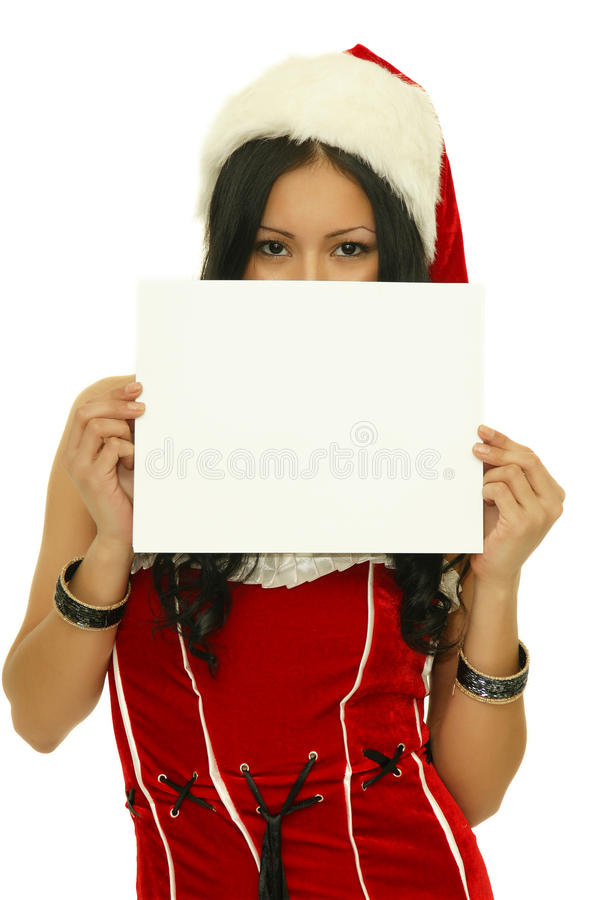 Christmas girl holding up a white sign royalty free stock images