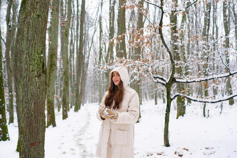 Christmas girl outdoor portrait. Portrait of a young woman in snow trying to warm herself. Christmas winter holidays royalty free stock images