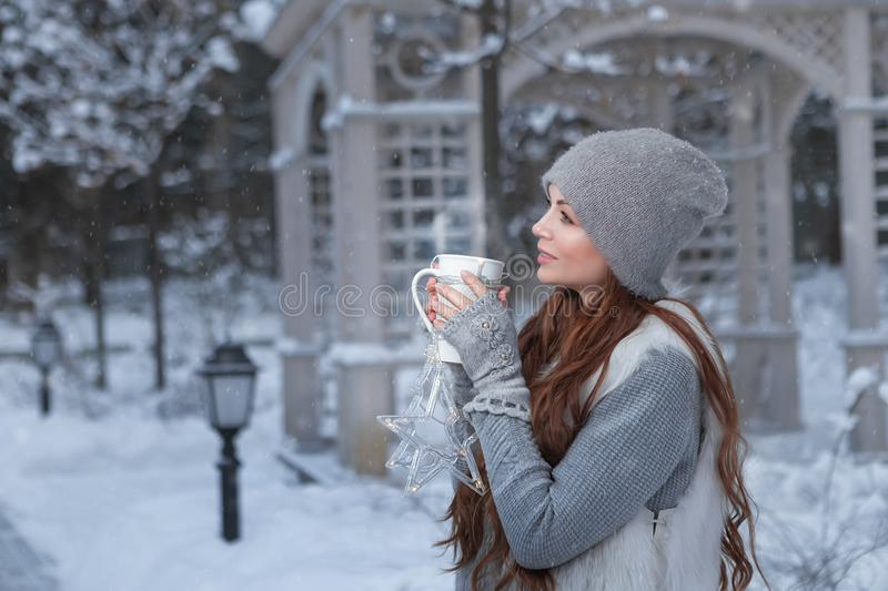 Woman with cup of tea in a park stock photography