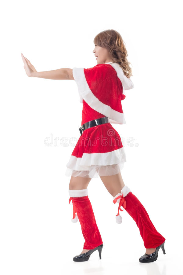 Christmas girl push something. Full length pose isolated royalty free stock images