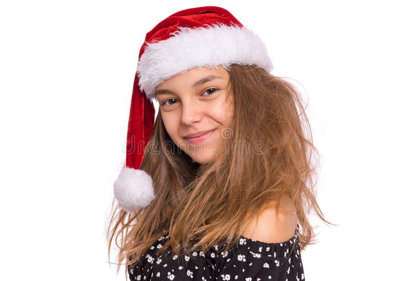 Christmas girl in santa hat royalty free stock photography