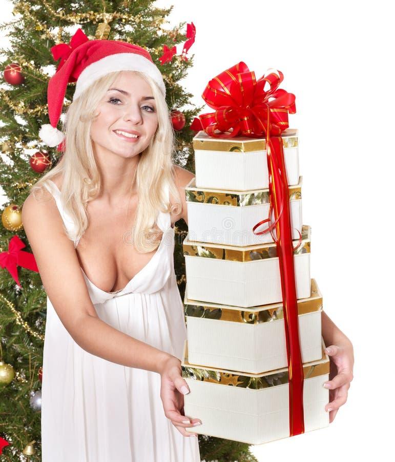 Christmas girl in santa hat holding stac gift box.