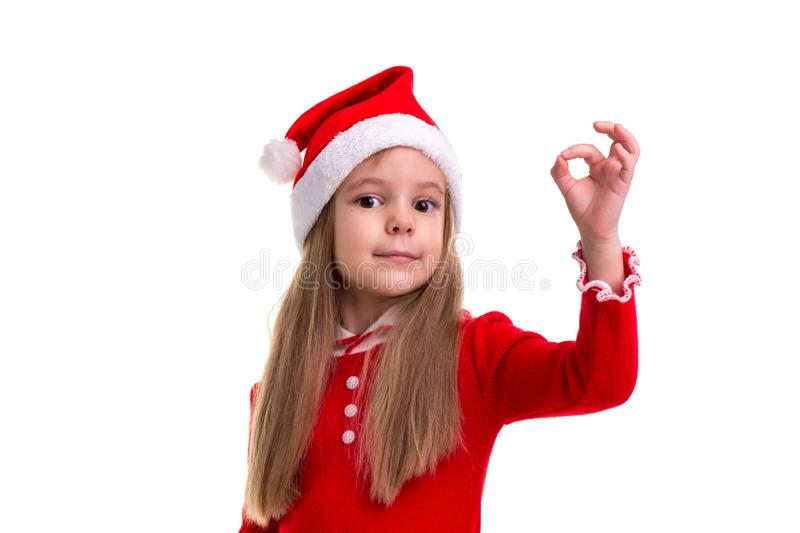 Christmas girl showing ok sign, wearing a santa costume, isolated over a white background stock photography