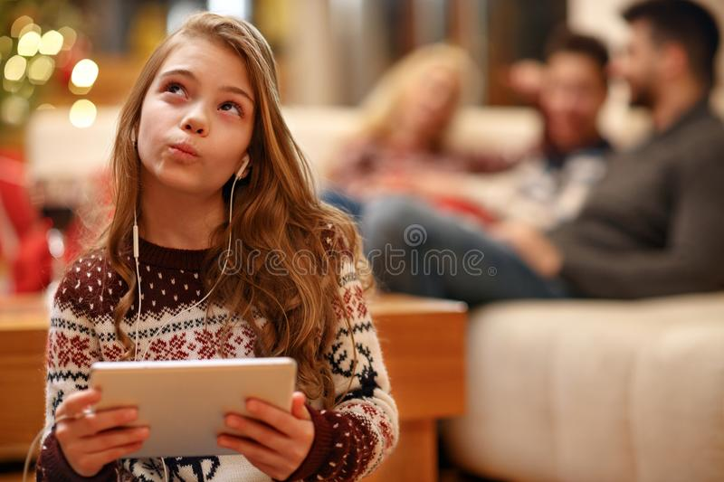 Girl thinking and listening music stock image